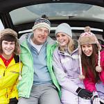 teenage-family-sitting-boot-car-24374818